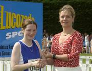 27th July 2002; Claire Byrne, Hacketstown, Co. Carlow, is presented with the Silver Medal by Rosemary Lyster, Marketing Manager, Lucozade Sport, after the U.18 3,000m Walk Final at the Lucozade Sport AAI Juvenile Track & Field Championship of Ireland 2002, Tullamore Harriers Stadium, Tullamore, Co. Offaly. Athletics. Picture credit; Ray McManus / SPORTSFILE *EDI*
