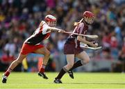 16 September 2012; Catriona Cormican, Galway, in action against Sinead Cassidy, Derry. All-Ireland Intermediate Camogie Championship Final, Derry v Galway, Croke Park, Dublin. Picture credit: David Maher / SPORTSFILE
