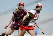 16 September 2012; Karen Kielt, Derry, in action against Catriona Cormican, Galway. All-Ireland Intermediate Camogie Championship Final, Derry v Galway, Croke Park, Dublin. Picture credit: Paul Mohan / SPORTSFILE