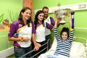 17 September 2012; Jacqueline Burns, from Nurney, Co. Kildare, holds the O'Duffy Cup with members of the Wexford team, from left, Deirdre Codd, Stacey Redmond and selector Joe Brennan during a visit to Our Lady's Hospital for Sick Children, Crumlin, Dublin. Picture credit: David Maher / SPORTSFILE