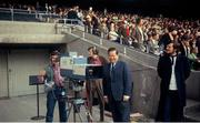 Undated picture, probably 1972, of Michael O'Hehir beside an RTÉ camera in the entrance to the Hogan Stand, Croke Park, Dublin. Picture credit: Connolly Collection / SPORTSFILE