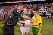 23 September 2012; Mascots Jack Malone, left, Mayo, and Jamie Crawford, Donegal, present the match football to referee Maurice Deegan before the start of the game. GAA Football All-Ireland Senior Championship Final, Donegal v Mayo, Croke Park, Dublin. Picture credit: David Maher / SPORTSFILE