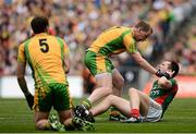23 September 2012; Cillian O'Connor, Mayo, clashes with Anthony Thompson, centre, and Eamon McGee, Donegal. GAA Football All-Ireland Senior Championship Final, Donegal v Mayo, Croke Park, Dublin. Picture credit: David Maher / SPORTSFILE