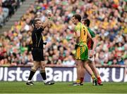 23 September 2012; Referee Maurice Deegan shows the yellow card to both Eamon McGee, Donegal, Cillian O'Connor, Mayo. GAA Football All-Ireland Senior Championship Final, Donegal v Mayo, Croke Park, Dublin. Picture credit: David Maher / SPORTSFILE