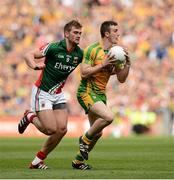 23 September 2012; Leo McLoone, Donegal, in action against Aidan O'Shea, Mayo. GAA Football All-Ireland Senior Championship Final, Donegal v Mayo, Croke Park, Dublin. Picture credit: David Maher / SPORTSFILE