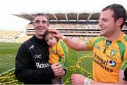 23 September 2012; Donegal manager Jim McGuinness celebrates at the end of the game with his son Jimmy, age 18 months, and team captain Michael Murphy. GAA Football All-Ireland Senior Championship Final, Donegal v Mayo, Croke Park, Dublin. Picture credit: David Maher / SPORTSFILE