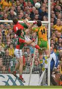 23 September 2012; Michael Murphy, Donegal, gets to the ball ahead of Mayo goalkeeper David Clarke and full-back Ger Cafferkey, to score a point. GAA Football All-Ireland Senior Championship Final, Donegal v Mayo, Croke Park, Dublin. Picture credit: Brendan Moran / SPORTSFILE