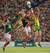 23 September 2012; Rory Kavanagh and Leo McLoone, Donegal, in action against Jason Doherty and Aidan O'Shea, Mayo. GAA Football All-Ireland Senior Championship Final, Donegal v Mayo, Croke Park, Dublin. Picture credit: Oliver McVeigh / SPORTSFILE