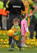 23 September 2012; Mark Anthony McGuinness, son of Donegal manager Jim McGuinness, plays with a football on the pitch after the presentation of the Sam Maguire cup. GAA Football All-Ireland Senior Championship Final, Donegal v Mayo, Croke Park, Dublin. Picture credit: Brendan Moran / SPORTSFILE
