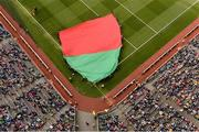 23 September 2012; A large flag in the Mayo colours is brought out into the pitch as part of the pre-match festivities. GAA Football All-Ireland Senior Championship Final, Donegal v Mayo, Croke Park, Dublin. Picture credit: Brendan Moran / SPORTSFILE