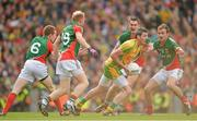 23 September 2012; Christy Toye, Donegal, in action against Mayo players, from left, Donal Vaughan, Richie Feeney, Barry Moran and Jason Gibbons. GAA Football All-Ireland Senior Championship Final, Donegal v Mayo, Croke Park, Dublin. Picture credit: Brendan Moran / SPORTSFILE