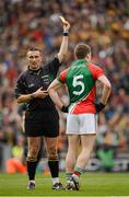 23 September 2012; Referee Maurice Deegan shows the yellow card to Lee Keegan, Mayo. GAA Football All-Ireland Senior Championship Final, Donegal v Mayo, Croke Park, Dublin. Picture credit: Ray McManus / SPORTSFILE