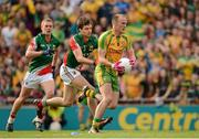23 September 2012; Colm McFadden, Donegal, is tackled by Ger Cafferkey, centre, and Kevin Keane, left, Mayo. GAA Football All-Ireland Senior Championship Final, Donegal v Mayo, Croke Park, Dublin. Picture credit: Ray McManus / SPORTSFILE