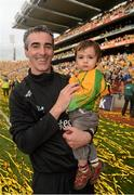 23 September 2012; Donegal manager Jim McGuinness, with his son Jimmy, age 8 months, celebrates after the game. GAA Football All-Ireland Senior Championship Final, Donegal v Mayo, Croke Park, Dublin. Picture credit: Ray McManus / SPORTSFILE