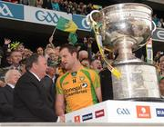 23 September 2012; Donegal captain Michael Murphy shakes hands with Uachtarán Chumann Lúthchleas Gael Liam Ó Néill while Michael D. Higgins, President of Ireland looks on, before the presentation of the Sam Maguire Cup. GAA Football All-Ireland Senior Championship Final, Donegal v Mayo, Croke Park, Dublin. Picture credit: Ray McManus / SPORTSFILE