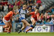 7 October 2012; Hannah Landers shoots past Armagh defenders Clodagh McCann, left, and Laura Brown to score a first half goal for Waterford. TG4 All-Ireland Ladies Football Intermediate Championship Final, Armagh v Waterford, Croke Park, Dublin. Picture credit: Ray McManus / SPORTSFILE