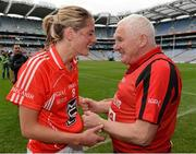 7 October 2012; Cork's Juliet Murphy celebrates with manager Eamonn Ryan after the game. TG4 All-Ireland Ladies Football Senior Championship Final, Cork v Kerry, Croke Park, Dublin. Picture credit: Brendan Moran / SPORTSFILE