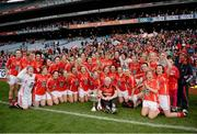 7 October 2012; The Cork team, including manager Eamonn Ryan, celebrate with the Brendan Martin Cup after the game. TG4 All-Ireland Ladies Football Senior Championship Final, Cork v Kerry, Croke Park, Dublin. Picture credit: Ray McManus / SPORTSFILE