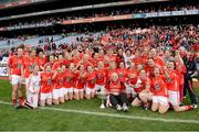 7 October 2012; The Cork team, including manager Eamonn Ryan, celebrate with the Brendan Martin Cup after the game. TG4 All-Ireland Ladies Football Senior Championship Final, Cork v Kerry, Croke Park, Dublin. Picture credit: Brendan Moran / SPORTSFILE