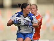 7 October 2012; Michelle McGrath, Waterford, in action against Marian McGuinness, Armagh. TG4 All-Ireland Ladies Football Intermediate Championship Final, Armagh v Waterford, Croke Park, Dublin. Picture credit: Brendan Moran / SPORTSFILE