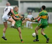 14 October 2012; Mark Dunne and Ciaran Heavey, right, Rhode, in action against Scott Brady, Clara. Offaly County Senior Football Championship Final, Rhode v Clara, O'Connor Park, Tullamore, Co. Offaly. Picture credit: Brian Lawless / SPORTSFILE