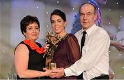 10 November 2012; Kerry's Sarah Houlihan with her mother Doreen and father Jerry and her TG4 O'Neill's All-Star award. TG4 O'Neill's Ladies Football All-Star Awards 2012, Citywest Hotel, Saggart, Co. Dublin. Picture credit: Brendan Moran / SPORTSFILE
