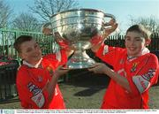9 February 2003; 13 year old Cork fans Cathal Hickey, Whites Cross, left, and Stuart Landers, Mayfield, get an opportunity to hold the Sam Maguire Cup outside the ground before the game. Allianz National Football League Division 1A, Armagh v Cork, St. Oliver Plunkett Park, Crossmaglen, Co. Armagh. Picture credit; Ray McManus / SPORTSFILE