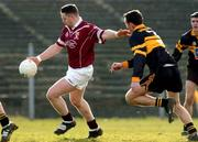 23 February 2003; Liam Moffatt, Crossmolina, fires in his shot to score his sides third goal depite the challange from Ken McTigue, Dunshaughlin. AIB All Ireland Club Football Championship Semi-final. Crossmolina v Dunshaughlin. Dr. Hyde Park, Roscommon. Picture credit; David Maher / SPORTSFILE *EDI*