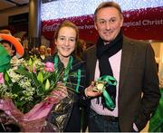 10 December 2012; Team Ireland's Fionnuala Britton who won two gold medals, one in the Senior Women's race and the other as a  member of the overall winning team at the SPAR European Cross Country Championships in Budapest, Hungary, pictured with her coach Chris Jones on her return at Dublin Airport. Picture credit: David Maher / SPORTSFILE