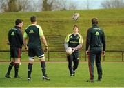18 December 2012; Munster's Ian Keatley, watched by team-mates, from left, JJ Hanrahan, Niall Ronan and Danny Barnes, in action during squad training ahead of their Celtic League 2012/13 game against Connacht on Saturday. University of Limerick, Limerick. Picture credit: Diarmuid Greene / SPORTSFILE