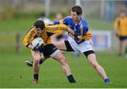 6 January 2013; Colin Compton, DCU, in action against Luke Benson, Wicklow. Bórd na Móna O'Byrne Cup, Group B, Wicklow v DCU. Éire Óg Greystones GAA Club, Greystones, Co. Wicklow. Picture credit: Stephen McCarthy / SPORTSFILE