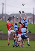 6 January 2013; John Heslin, UCD, supported by team-mates Craig Dias, left, and Rory O'Carroll, in action against Dessie Finnegan, left, and Mark Brennan, Louth. Bórd na Móna O'Byrne Cup, Group A, Louth v UCD, County Grounds, Drogheda, Co. Louth. Picture credit: Paul Mohan / SPORTSFILE