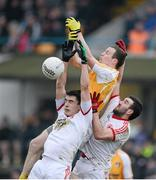 13 January 2013; Michael McCann, Antrim, in action against Sean Warnock and Dean McNally, Tyrone. Power NI Dr. McKenna Cup, Section C, Round 2, Antrim v Tyrone, Casement Park, Belfast, Co. Antrim. Picture credit: Oliver McVeigh / SPORTSFILE