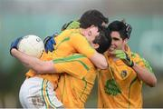 13 January 2013; Emlyn Mulligan, right, Leitrim captain celebrates with Wayne McKeon, centre and Paddy McGowan, at the end of the game. Connacht FBD League Section B, Leitrim v Mayo, Páirc Seán O'Heslin, Ballinamore, Co. Leitrim. Picture credit: David Maher / SPORTSFILE
