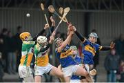 13 January 2013; Offaly players, from left, Pat Camon, and Kevin Brady in action against Timmy Hammersley, Noel McGrath and Johnny Ryan, Tipperary. Inter-County Challenge Match, Tipperary v Offaly, Templemore, Co. Tipperary. Picture credit: Matt Browne / SPORTSFILE