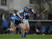 20 January 2013; Conor Ailis, UCD, in action against Cahir Healy, Laois. Bord na M—na Walsh Cup, First Round, Laois v UCD, Rathdowney-Errill GAA Club, Kelly Daly Park, Rathdowney, Co. Laois. Picture credit: Dáire Brennan / SPORTSFILE