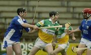 13 April 2003; Joe Errity, Offaly, in action against Patrick Cuddy, left, and Michael McEvoy, Laois. Allianz National Hurling League, Division 1, St Brendan's Park, Birr, Co. Offaly. Picture credit; Brendan Moran / SPORTSFILE *EDI*