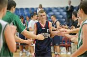 "25 January 2013; Sean Flood, Templeogue College, is given high fives by the players from St Malachy's Belfast as he makes his way up to collect his runners'-up medal. All-Ireland Schools Cup U19A Boys Final, St Malachy's Belfast, Antrim v Templeogue College/St Josephs ""Bish"", National Basketball Arena, Tallaght, Dublin. Picture credit: Brendan Moran / SPORTSFILE"