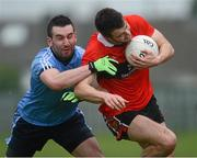 29 January 2013; Jamie O'Sullivan, UCC, in action against Dean McNally, UUJ. Irish Daily Mail Sigerson Cup, Round 1, UCC v UUJ, Parnells GAA Club, Coolock, Dublin. Picture credit: Brian Lawless / SPORTSFILE