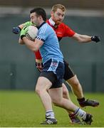 29 January 2013; Dean McNally, UUJ, in action against JB Spillane, UCC. Irish Daily Mail Sigerson Cup, Round 1, UCC v UUJ, Parnells GAA Club, Coolock, Dublin. Picture credit: Brian Lawless / SPORTSFILE