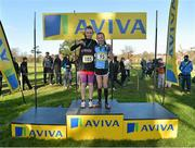 6 February 2013; Jodie McCann, right, Rathdown, Dublin, winner of the minor girl's race, on the podium with third placed finisher Nicola Duffy, St. Peter's Dunboyne, Co. Meath. 2013 AVIVA Leinster Schools cross country championships, Santry Demesne, Santry, Co. Dublin. Picture credit: Barry Cregg / SPORTSFILE