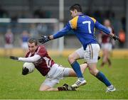 10 February 2013; Michael Curley, Westmeath, in action against Shane Mulligan, Longford. Allianz Football League, Division 2, Longford v Westmeath, Pearse Park, Longford. Picture credit: Oliver McVeigh / SPORTSFILE