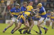 18 May 2003; Sean McMahon, Clare, collects the sliothar ahead of team-mate Brian Quinn (2) and Tipperary's Eoin Kelly, left, Conor Gleeson and Lar Corbett. Guinness Munster Senior Hurling Championship, Clare v Tipperary, Pairc Ui Chaoimh, Cork. Picture credit; Brendan Moran / SPORTSFILE *EDI*