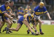 18 May 2003; Sean McMahon, Clare, in action against Tipperary's Lar Corbett, right, as Conor Gleeson, Tipperary and Brian Quinn, Clare, await developments. Guinness Munster Senior Hurling Championship, Clare v Tipperary, Pairc Ui Chaoimh, Cork. Picture credit; Brendan Moran / SPORTSFILE *EDI*