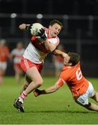 9 March 2013; James Kielt, Derry, in action against Brendan Donaghy, Armagh. Allianz Football League, Division 2, Derry v Armagh, Celtic Park, Derry. Picture credit: Oliver McVeigh / SPORTSFILE