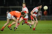 9 March 2013; Daniel Haveron, Derry, in action against Brendan Donaghy, Armagh. Allianz Football League, Division 2, Derry v Armagh, Celtic Park, Derry. Picture credit: Oliver McVeigh / SPORTSFILE