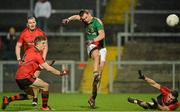 9 March 2013; Barry Moran, Mayo, ibeats Ryan Boyle, left, and Keith Quinn, right, Down to score a point. Allianz Football League, Division 1, Down v Mayo, Páirc Esler, Newry, Co. Down. Picture credit: Barry Cregg / SPORTSFILE