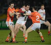 16 March 2013; Shane Lennon, Louth, in action against Bredan Donaghy and James Morgan, right, Armagh. Allianz Football League, Division 2, Armagh v Louth, Athletic Grounds, Armagh. Picture credit: Oliver McVeigh / SPORTSFILE