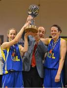 23 March 2013; UL Huskies co-captains Cathy Grant, left, and Michelle Fahy lift the Women's SuperLeague trophy in the company of Gerry Kelly, President, Basketball Ireland. Nivea Women's SuperLeague Final, UL Huskies v DCU Mercy, National Basketball Arena, Tallaght, Dublin. Picture credit: Brendan Moran / SPORTSFILE