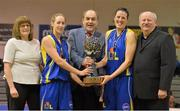 23 March 2013; UL Huskies co-captains Cathy Grant, second from left, and Michelle Fahy are presented with the Nivea Women's SuperLeague trophy by Gerry Kelly, president, Basketball Ireland, in the company of Margaret Miley, Chair, Competitions Standing Committee, Basketball Ireland, and Ken Clarke, Women's Clubs Committee, Basketball Ireland. Nivea Women's SuperLeague Final, UL Huskies v DCU Mercy, National Basketball Arena, Tallaght, Dublin. Picture credit: Brendan Moran / SPORTSFILE